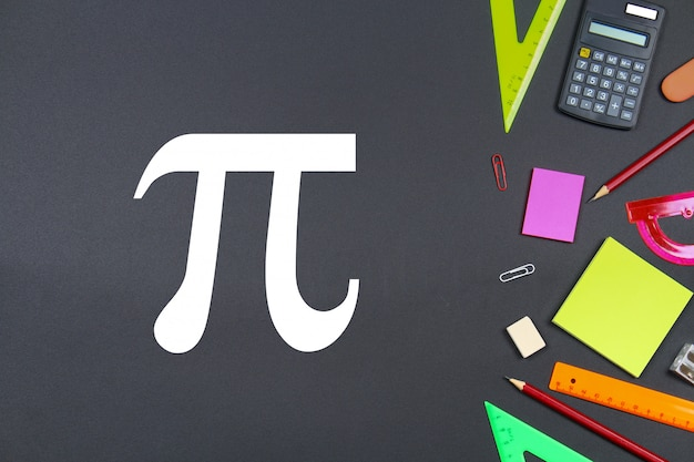 The inscription of pi day and chalk on a blackboard. Premium Photo