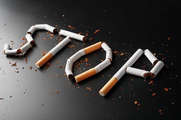 The inscription stop from cigarettes. stop smoking. the concept of smoking kills. motivation inscription to quit smoking, unhealthy habit. Premium Photo