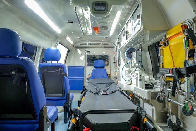 Inside an ambulance car with medical equipment for helping patients before delivery Premium Photo
