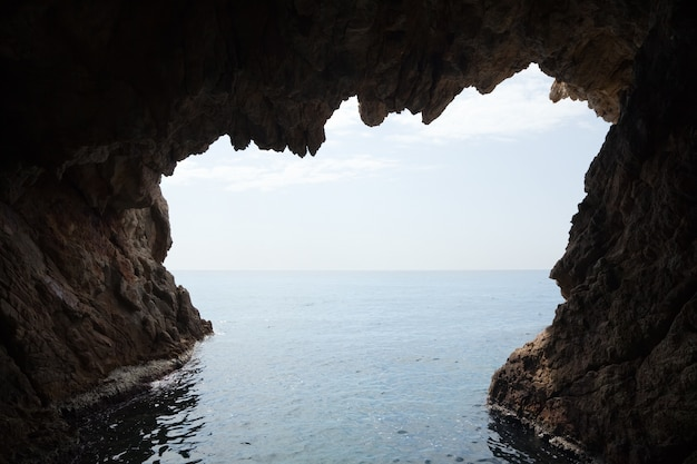 Inside  of cave  in cliff Free Photo