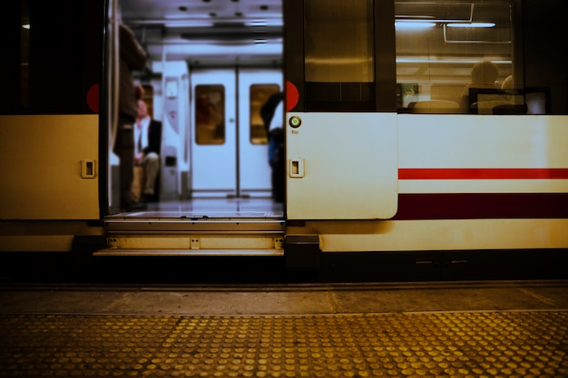 Inside view of train stopped with an open door Free Photo