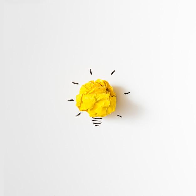 Inspiration crumpled yellow paper light bulb idea on white background Free Photo