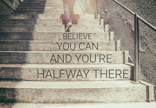 Inspirational quote on woman walk on stair background with vintage filter Premium Photo