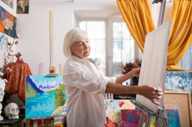 Inspired before painting. stylish aged beautiful artist with bob cut feeling inspired before painting Premium Photo