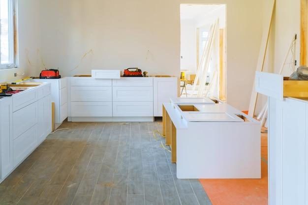 Installation modern kitchen cabinet of furniture details. Premium Photo