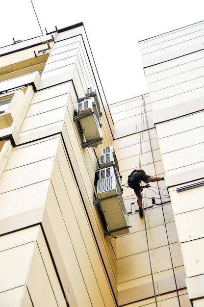 Installation of ventilation for construction climbers Premium Photo