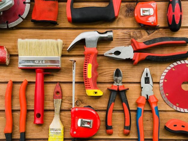 Instruments of carpenter on wooden desk Free Photo