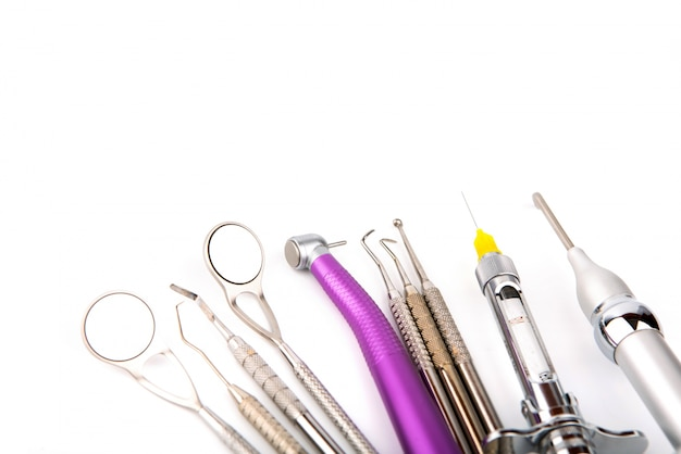 Instruments of a dentist with white background Free Photo