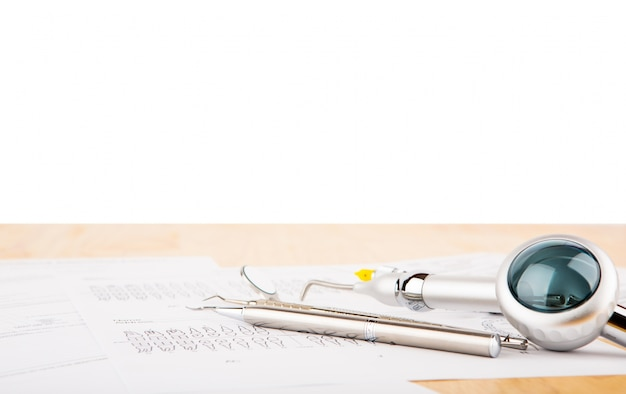 Instruments Of A Dentist With White Background Photo