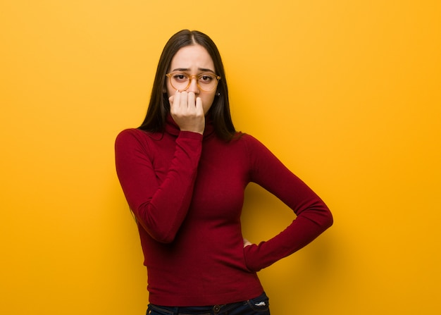 Intellectual young girl biting nails, nervous and very anxious Premium Photo