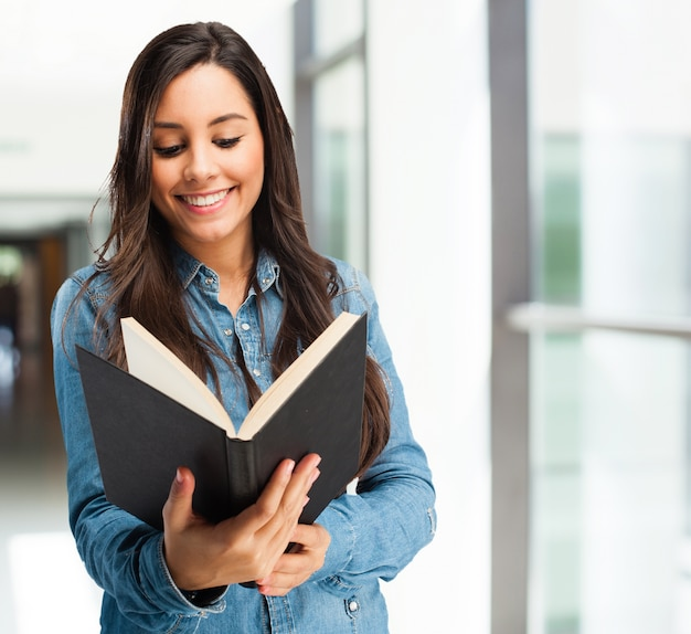 Intelligent student enjoying a good book Free Photo