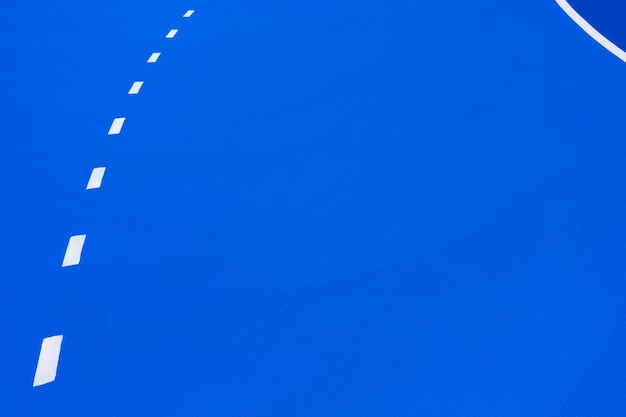 Intense blue basketball court background Premium Photo
