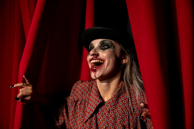 Intense shot of a halloween make-up woman laughing Free Photo