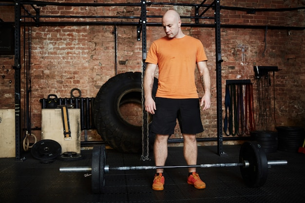 Intensive training with barbell Free Photo