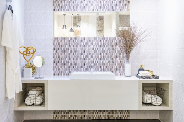 Interior of bathroom with washbasin faucet and white towel. modern design of bathroom. Premium Photo