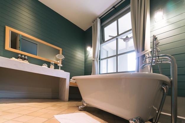 Interior of bathroom with white bath tub Premium Photo