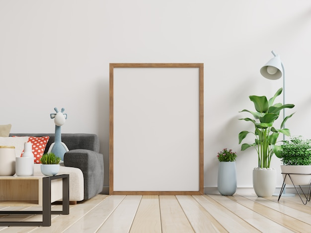 Interior blank photo frame with vertical empty with sofa and tree in room with white wall. Premium Photo