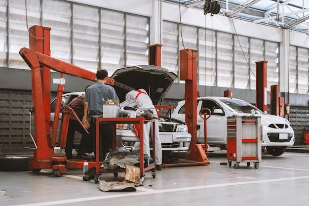 Interior of a  car repair in garage service station Premium Photo