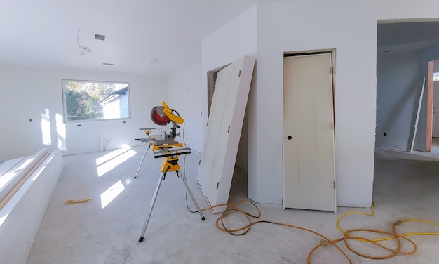 Interior construction of housing project with drywall installed door for a new home before installing Premium Photo