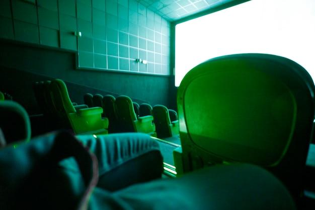 Interior of dark hall of cinema Free Photo