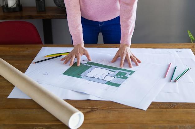 Interior designer studying blueprint Free Photo