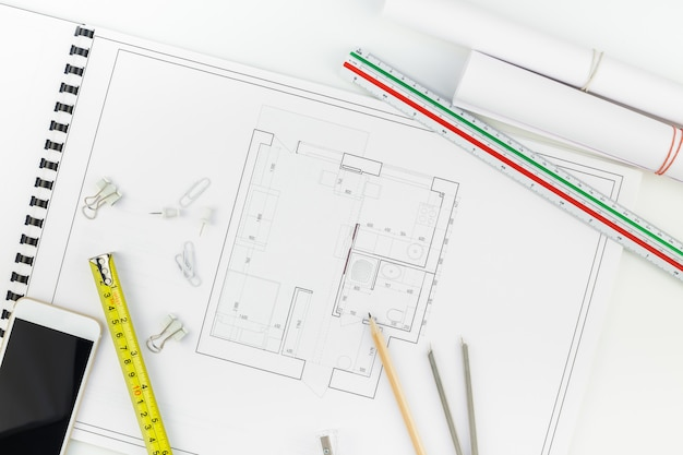 Interior designer table workplace with house plan Premium Photo