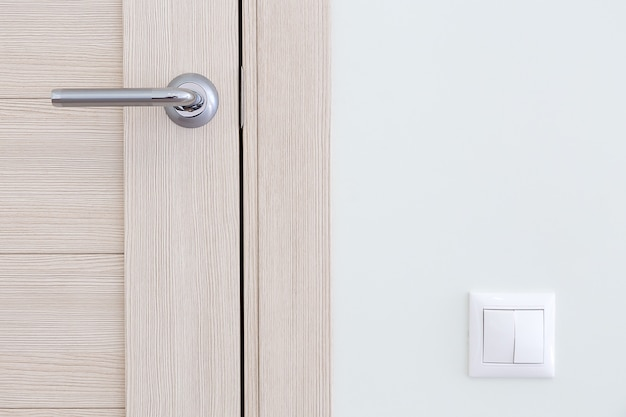 Interior detail. a door handle and a light switch Premium Photo