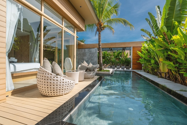 Interior and exterior design of luxury pool villa, house, home feature swimming pool, with bedroom Premium Photo