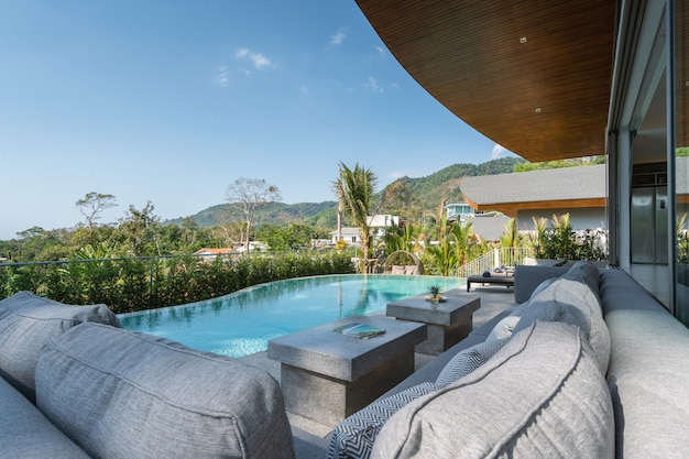 Interior and exterior design of pool villa, house, and home feature sun bed and infinity swimming pool Premium Photo