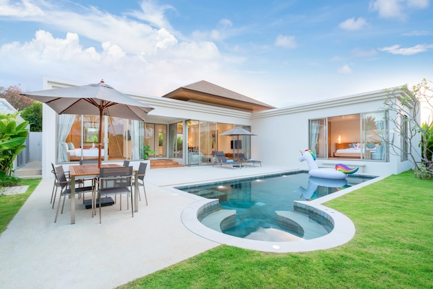 Interior and exterior design of pool villa which features living area Premium Photo