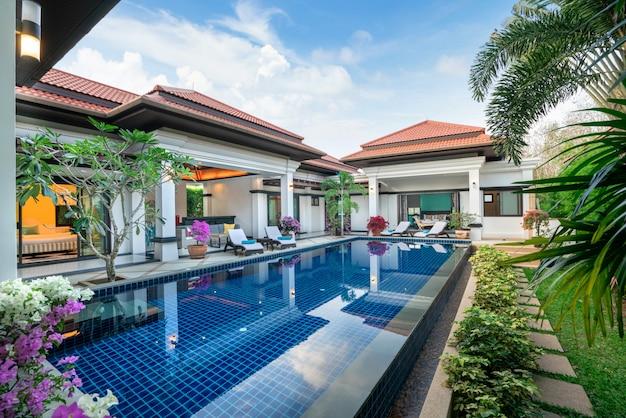 Interior and exterior design of pool villa which features living area Premium Photo