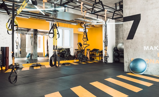 Interior of fitness club with exercise equipments Free Photo
