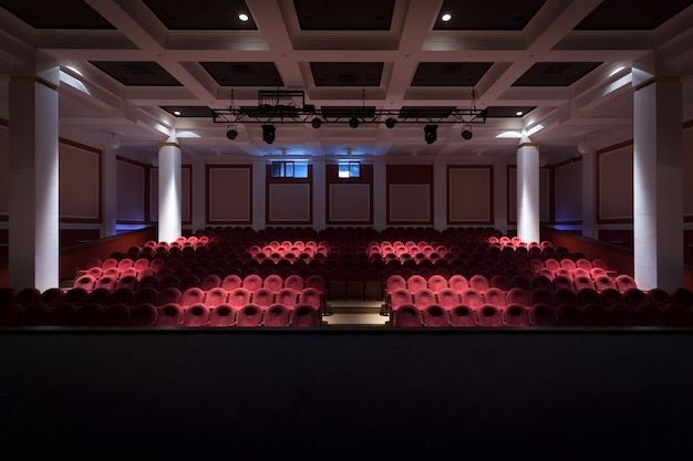 The interior of the hall in the theater or cinema view from the stage with muted light Premium Photo