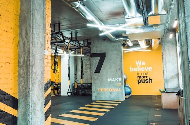 Interior of an illuminated fitness club Free Photo