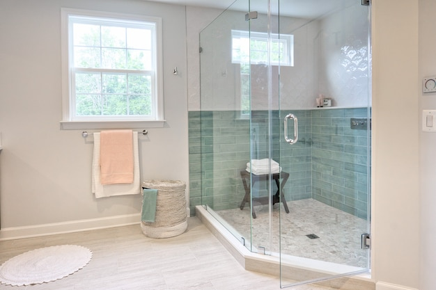 Interior of a modern bathroom with a shower box Free Photo