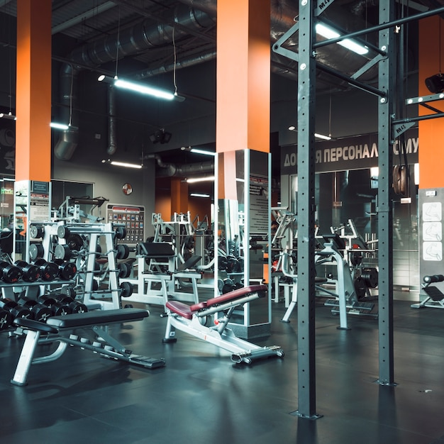 Interior of modern gym with equipments Free Photo