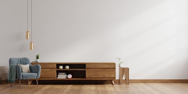 Интерьер яркой живущей комнаты с креслом на пустой белой предпосылке стены. Premium Фотографии
