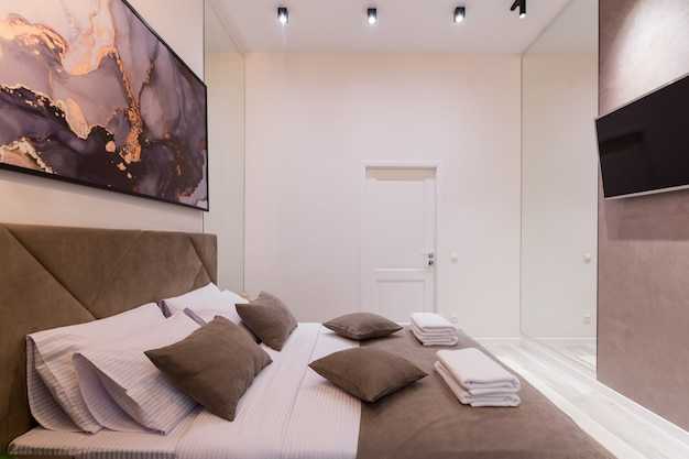 Premium Photo Interior Photography Modern Bedroom With Large Stylish Bed Modern Design In Beige