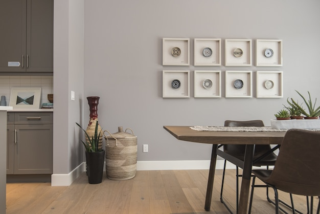 Interior shot of a modern house dining room with art on the wall Free Photo