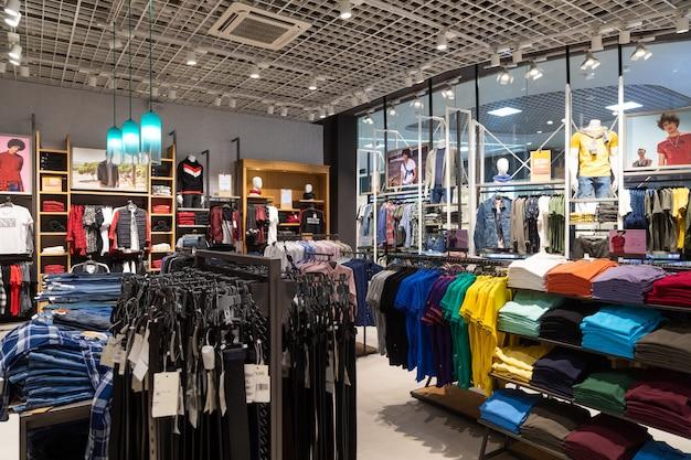Interior shot of racks with shirts, undershirts and jeans Premium Photo