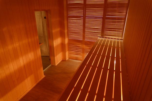 Interior of small home wooden sauna Premium Photo