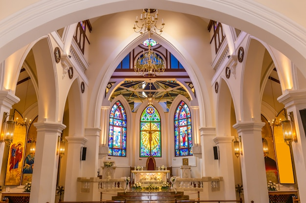 Interior view of beautiful colorful church with empty pews Premium Photo