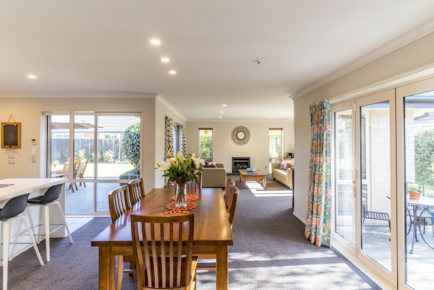 Interior with a bid dining room of a modern private house Free Photo