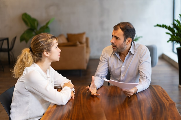 Intern and mentor discussing job specific Free Photo