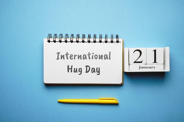International hug day of winter month calendar january. Premium Photo