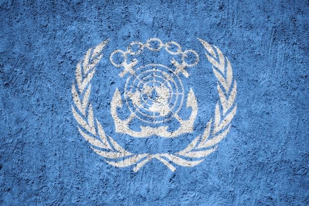 International maritime organization flag painted on grunge wall Premium Photo