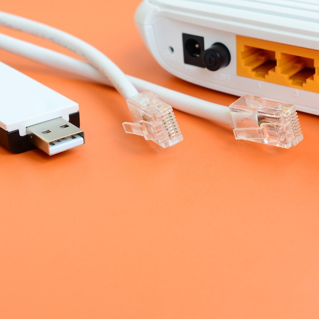 Internet router, portable usb wi-fi adapter and internet cable plugs Premium Photo