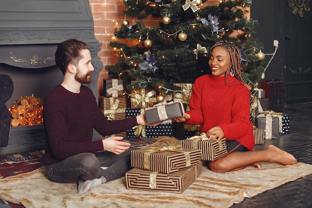 Free Photo Internetional People At Home Couple In A Christmas Decorations African Woman And Caucasian Man