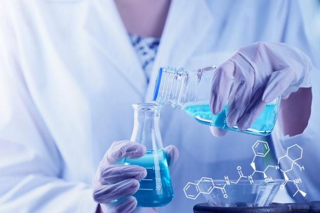 Investigator scientist hand checking test tubes Premium Photo