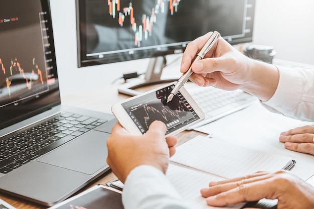 Investment stock market entrepreneur business team discussing and analysis graph stock market trading,stock chart concept Premium Photo